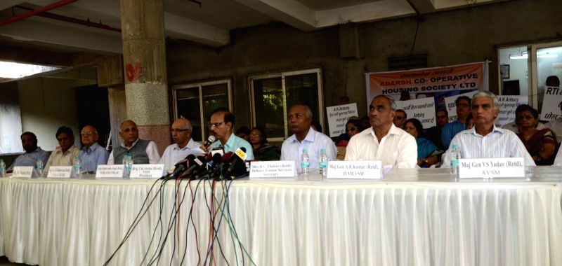 Members of Adarsh Co-operative Housing Society address a press conference in Mumbai, on Dec 20, 2014.