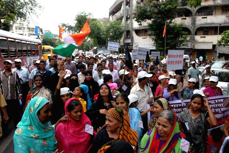 Members of NGO `Rashtriya Ekta Manch` protest to show solidarity with the dalit victims killed brutally at their Jawkheda village in Ahmednagar at Dadar in Mumbai on Nov. 15, 2014.