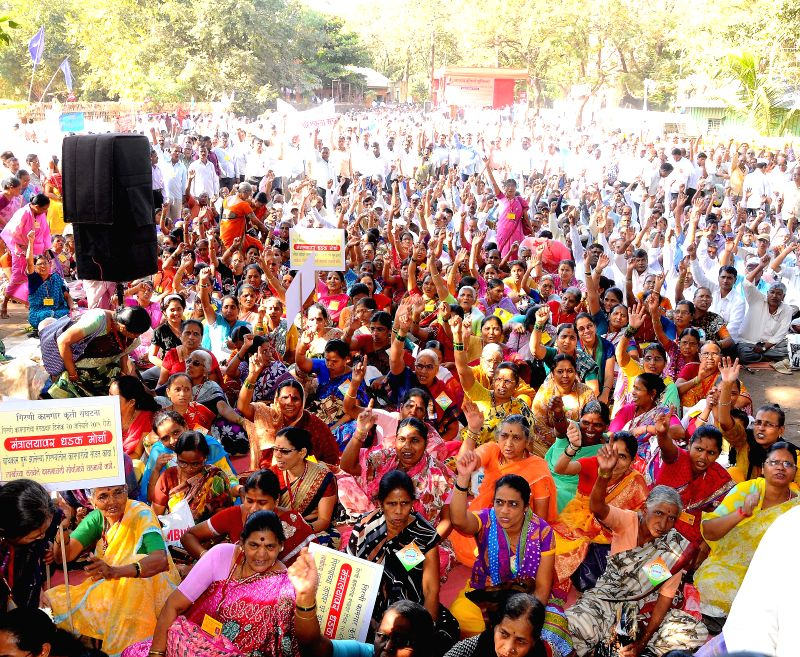 Mill workers participate in a protest rally to press for their demands at Azad Maidan in Mumbai, on Jan 20, 2015.
