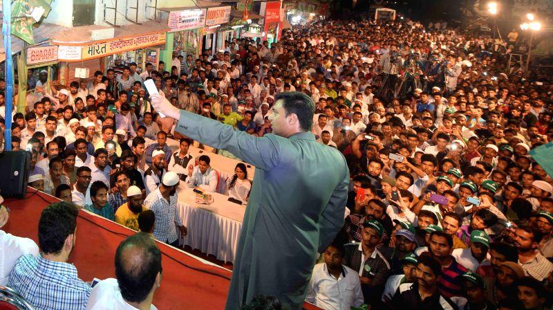 MIM leader Akbaruddin Owaisi addresses a rally at Bandra in Mumbai.