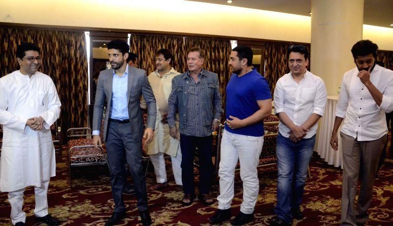 MNS chief Raj Thackeray with actors Aamir Khan, Salman Khan, Farhan Akhtar, Riteish Deshmukh, filmmaker Sajid Nadiadwala and screenwriter Salim Khan during a seminar convened by MNS chief Raj ... - Aamir Khan, Salman Khan, Farhan Akhtar and Riteish Deshmukh