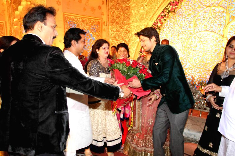 MNS Leader Raj Thackery with his wife Sharmila during the wedding reception of Congress leader Bhai Jagtap`s daughter, designer Manali Jagtap Shoor and Vicky Shoor in Mumbai, on Feb 11, 2015.
