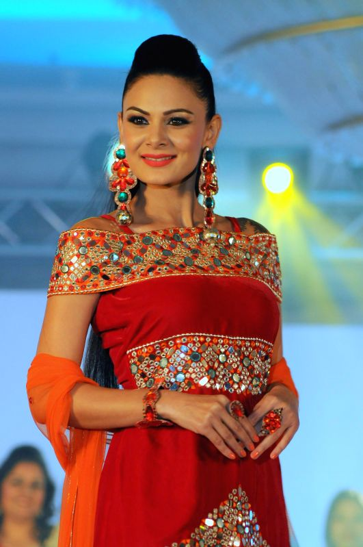 Model Aanchal Kumar displays the creation by the students of IITC Institute Global Careers during their annual fashion show organized in Mumbai, on Dec. 22, 2014. - Aanchal Kumar