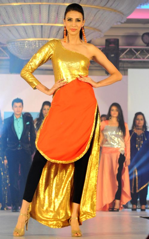 Model Alesia Raut displays the creation by the students of IITC Institute Global Careers during their annual fashion show organized in Mumbai, on Dec. 22, 2014. - Alesia Raut