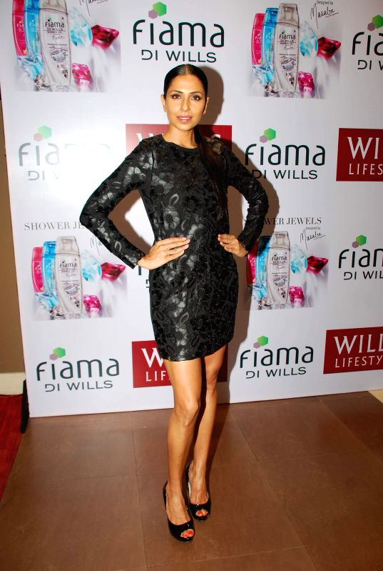 Model Candice Pinto during the launch of fiama DI wills shower jewels in Mumbai, on December 4, 2014. - Candice Pinto