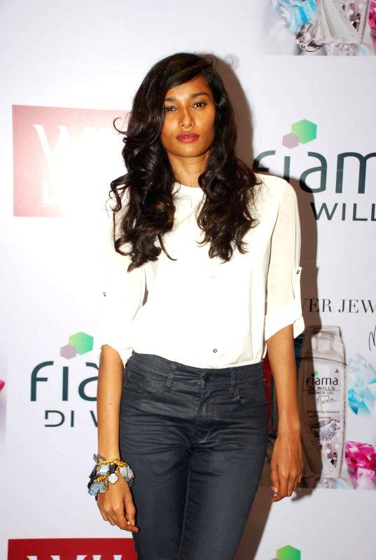 Model Nidhi Sunil during the launch of fiama DI wills shower jewels in Mumbai, on December 4, 2014. - Nidhi Sunil