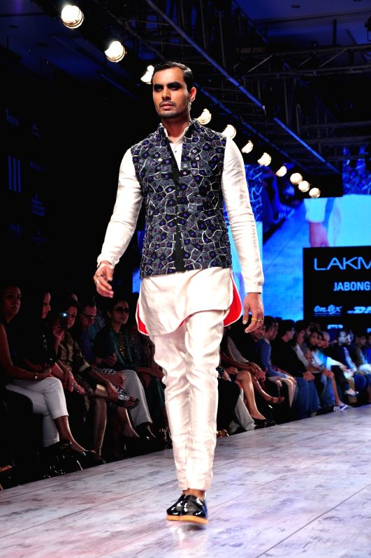 Model walk the ramp for designer Kunal Rawal show at the Lakme Fashion Week Summer/Resort 2015 in Mumbai on March 21, 2015