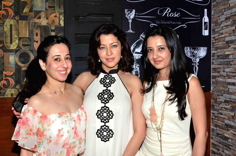 Models Alesia Raut with her son Mark, model Aditi Gowitrikar and fashion designer Amy Billimoria during the launch of Shine Young 2015 in Mumbai on 4th May 2015 - Aditi Gowitrikar