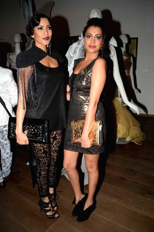 Models Himarsha Venkatsamy during the opening of fashion designer Gaurav Gupta's store in Mumbai on Nov 27, 2014.