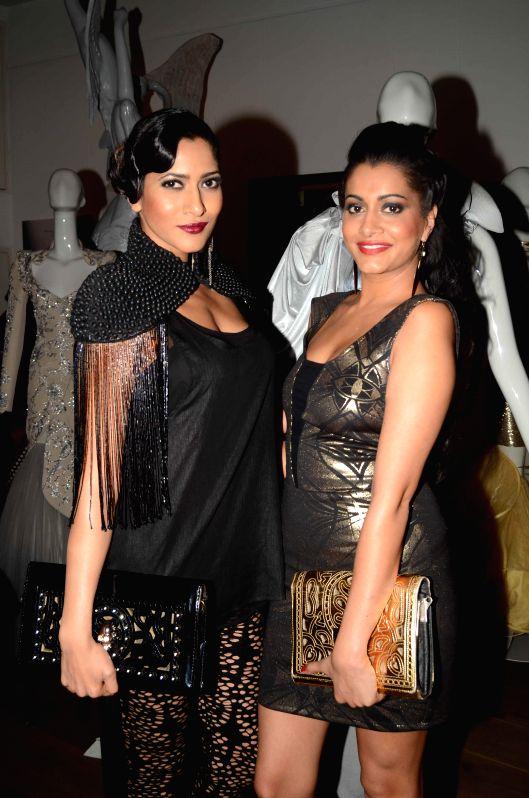 Models Himarsha Venkatsamy (L) and Terushka Venkatsamy during the opening of fashion designer Gaurav Gupta's store in Mumbai on Nov 27, 2014.
