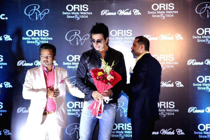Mr. Sanjay Mishra felicitating Actor Sonu Sood with Mr. Manoj Kataria during the unveiling of ORIS Pro Pilot Altimeter in Rama Watch Boutique, in Mumbai on Dec. 12, 2014. - Sanjay Mishra