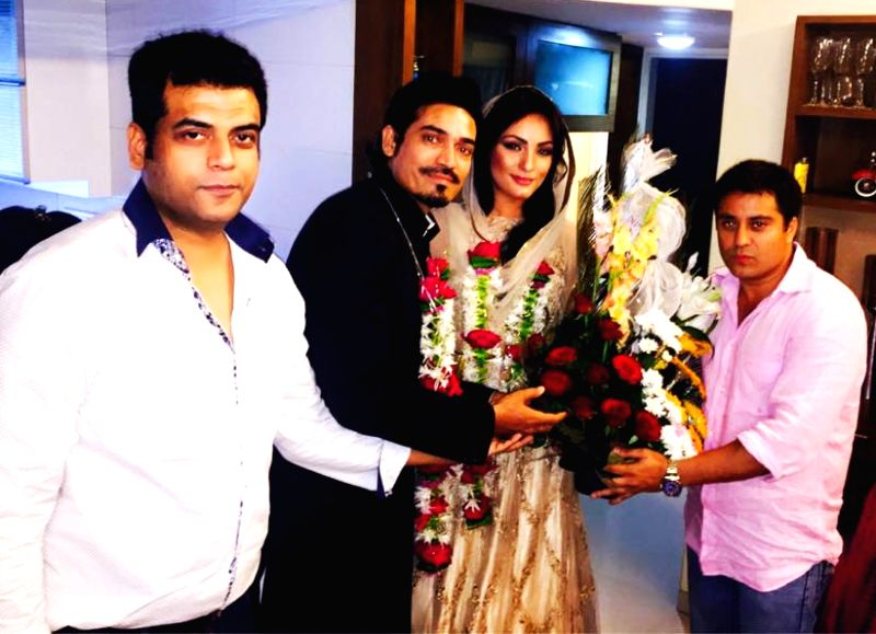 Mr. Waahiid Ali Khan (CMD-Sshaawn Group of Companies) and Designer Asif Shah with Bride and Groom Shawar Ali and Aisha Ali during their marriage ceremony in Mumbai. - Waahiid Ali Khan and Asif Shah