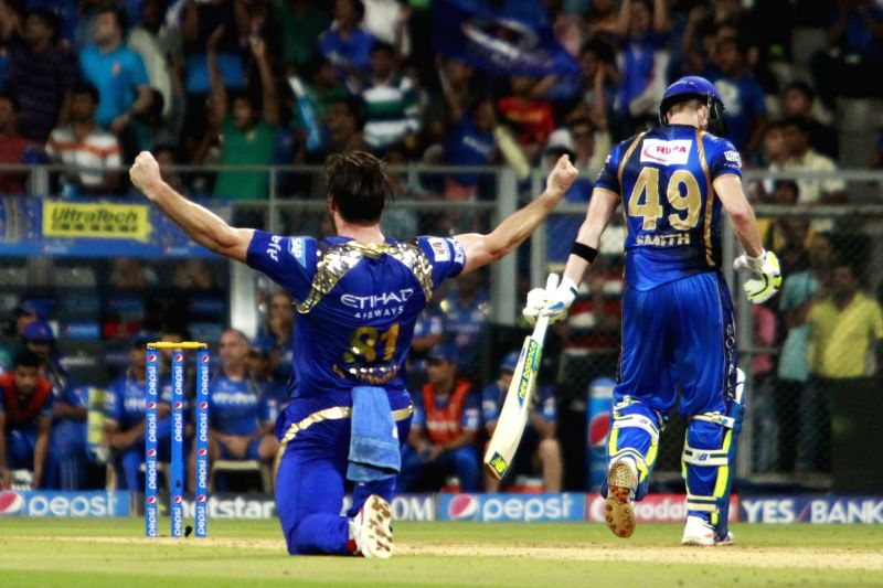 Mumbai Indians bowler Mitchell McClenaghan celebrates fall of Steven Smith's wicket during an IPL 2015 match between Rajasthan Royals and Mumbai Indians at the Wankhede Stadium in Mumbai, on ... - Mitchell M