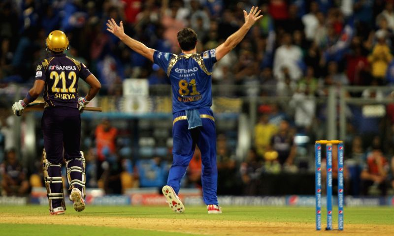 Mumbai Indians bowler Mitchell McClenaghan celebrates fall of Suryakumar Yadav's wicket during an IPL 2015 match between Mumbai Indians and Kolkata Knight Riders at Wankhede Stadium in Mumbai ... - Mitchell M and Suryakumar Yadav