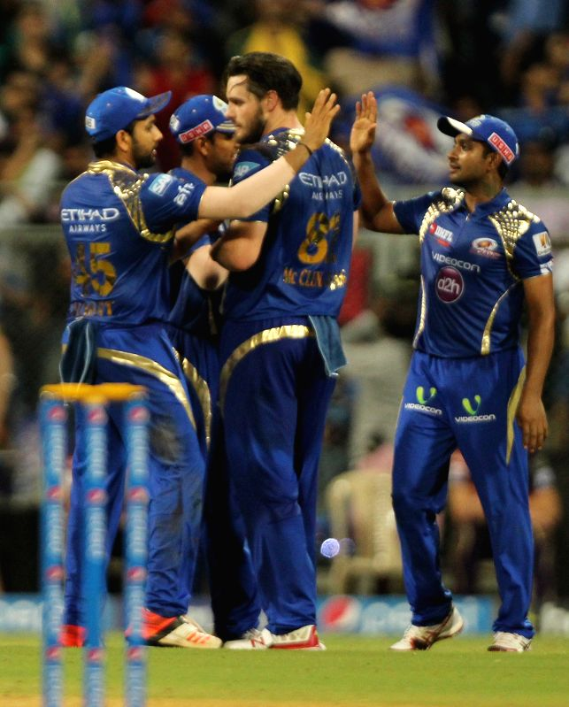 Mumbai Indians celebrate fall of Suryakumar Yadav's wicket during an IPL 2015 match between Mumbai Indians and Kolkata Knight Riders at Wankhede Stadium in Mumbai on May 14, 2015. - Suryakumar Yadav