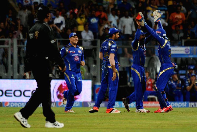 Mumbai Indians celebrate fall of a wicket during an IPL-2015 match between Mumbai Indians and Kings XI Punjab at Wankhede Stadium, in Mumbai, on April 12, 2015.