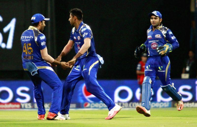 Mumbai Indians celebrate fall of a wicket during an IPL 2015 match between Rajasthan Royals and Mumbai Indians at the Wankhede Stadium in Mumbai, on May 1, 2015.