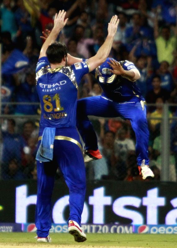 Mumbai Indians celebrate fall of Karun Nairs wicket during an IPL 2015 match between Rajasthan Royals and Mumbai Indians at the Wankhede Stadium in Mumbai, on May 1, 2015.