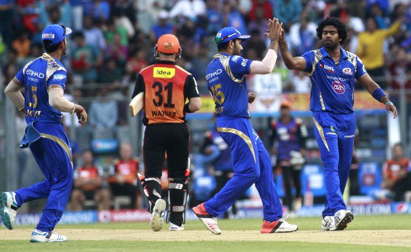 Mumbai Indians player Lasith Malinga celebrates fall of David Warner`s wicket during an IPL-2015 match between Mumbai Indians and Sunrisers Hyderabad at Wankhede Stadium, in Mumbai, on April ...