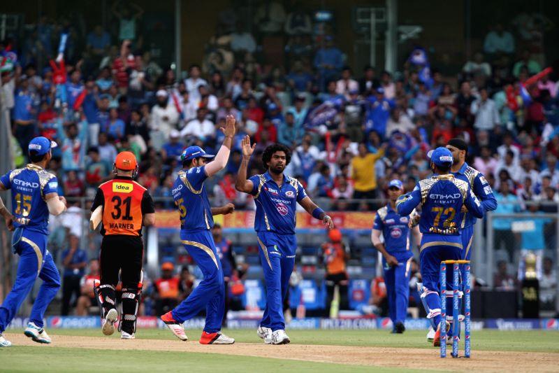 Mumbai Indians player Lasith Malinga celebrates fall of wicket during an IPL-2015 match between Mumbai Indians and Sunrisers Hyderabad at Wankhede Stadium, in Mumbai, on April 25, 2015.