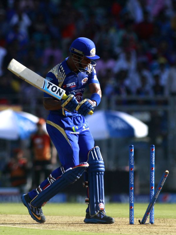 Mumbai Indians player Lendl Simmons reacts to being clean bowled by Dale Steyn of Sunrisers Hyderabad during an IPL-2015 match between Mumbai Indians and Sunrisers Hyderabad at Wankhede ...
