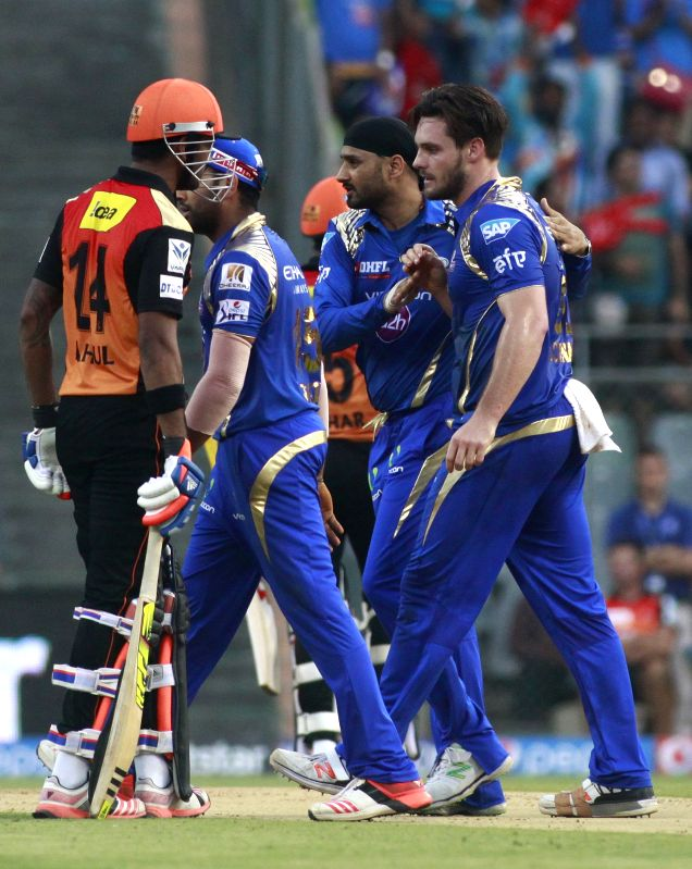 Mumbai Indians player Mitchell McClenaghan celebrates fall of Shikhar Dhawan`s wicket during an IPL-2015 match between Mumbai Indians and Sunrisers Hyderabad at Wankhede Stadium, in Mumbai, ...