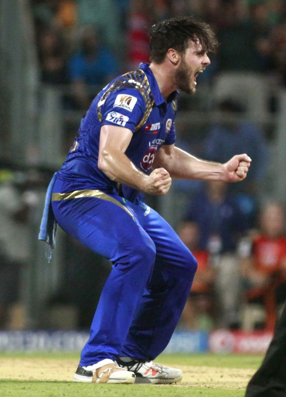 Mumbai Indians player Mitchell McClenaghan celebrates fall of wicket during an IPL-2015 match between Mumbai Indians and Sunrisers Hyderabad at Wankhede Stadium, in Mumbai, on April 25, 2015.