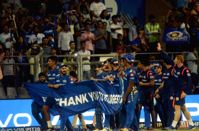 Mumbai Indians' players take a victory lap after the end of the 56th match of IPL 2019 between Kolkata Knight Riders and Mumbai Indians at Wankhede Stadium in Mumbai at Wankhede Stadium in Mumbai