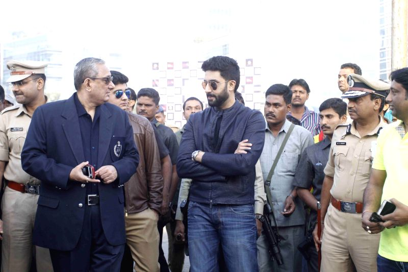 Mumbai Police Commissioner and also the Chief of Anti Terrorist Squad Rakesh Maria and Bollywood actor Abhishek Bachchan cheer and support for the cause of Ride for Safety event, in Mumbai, ..