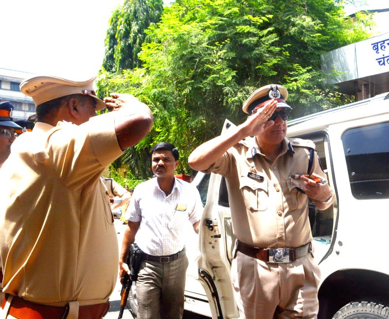 Mumbai Police Commissioner Rakesh Maria arrives to attend the funeral of Senior Police Inspector Vilas Joshi, who succumbed to his injuries after being shot at by his subordinate, in Mumbai, ...