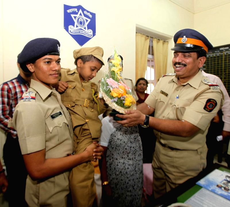 Mumbai police fulfills the wish of Mahak Singh, a 7-year-old cancer patient of becoming a police officer at Bhoiwada police station in Mumbai on Feb 13, 2015. - Mahak Singh