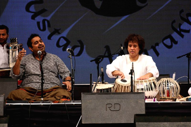 Music composer and singer Shankar Mahadevan and Tabla maestro Ustad Zakir Hussain performs during the concert organised by Ustad Allarakha Institute of Music to mark the death anniversary of . - Ustad Allarakha Khan