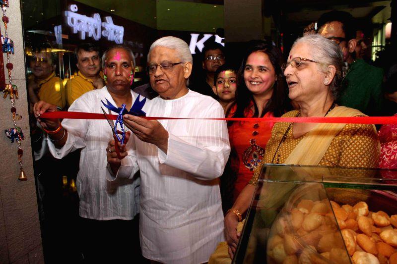 Music composer Pyarelal Ramprasad Sharma along with his wife Pammi during the inauguration of Sanskriti restaurant in Mumbai on March 5, 2015. - Pyarelal Ramprasad Sharma