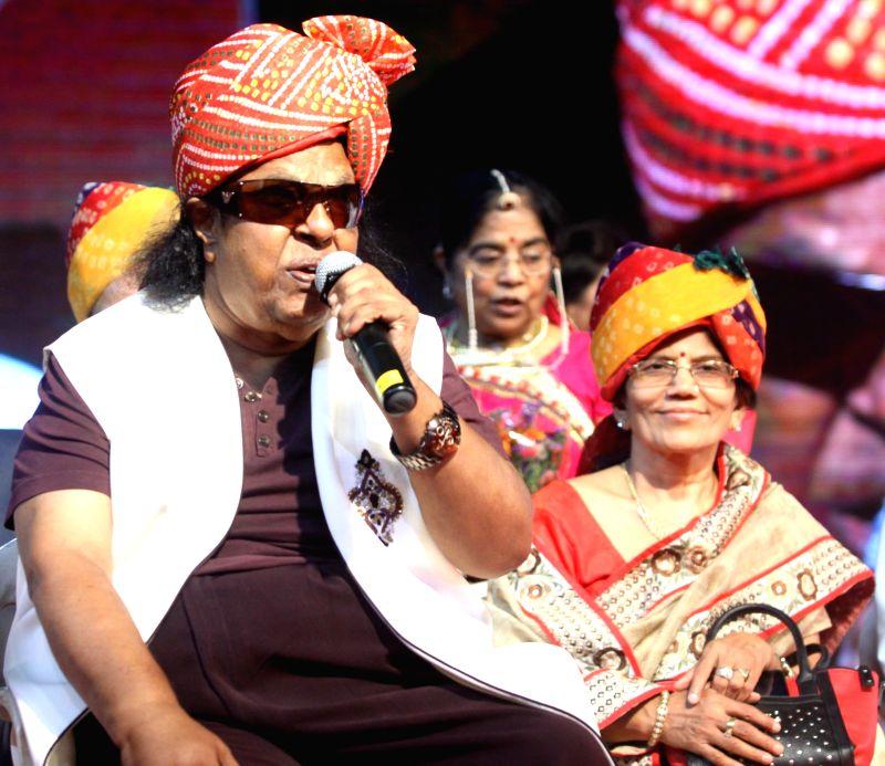 Music composer Ravindra Jain during the Rajasthan Day celebration in Mumbai on March 30, 2015. - Ravindra Jain