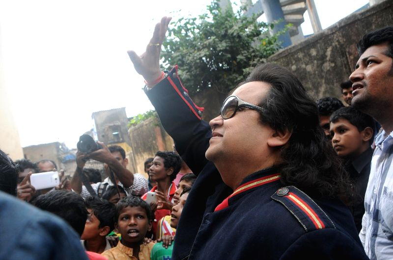 Music director Bappi Lahiri during the recording of songs for the band, the `Slumstars`.