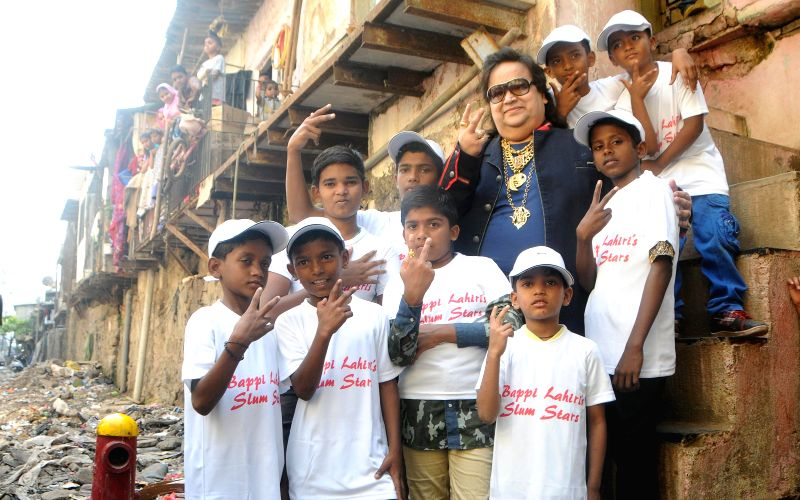 Music director Bappi Lahiri with slum kids during the recording of songs for the band, the `Slumstars`.