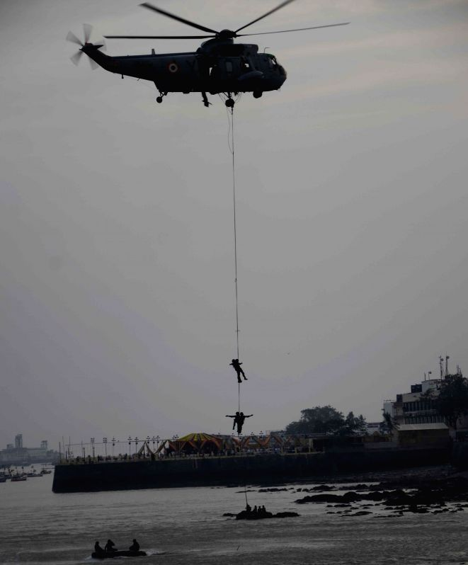 Navy personnel demonstrate their skills during Navy Day celebrations in Mumbai, on Dec 4, 2014.