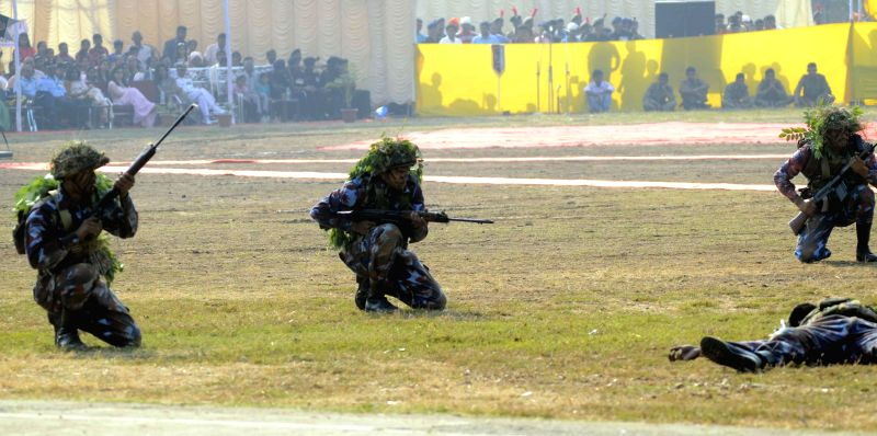 NCC cadets participate in a battle drill during the 66th anniversary celebration of NCC raising day in at Garrison Parade Ground, Colaba, Mumbai, on Nov 22, 2014.