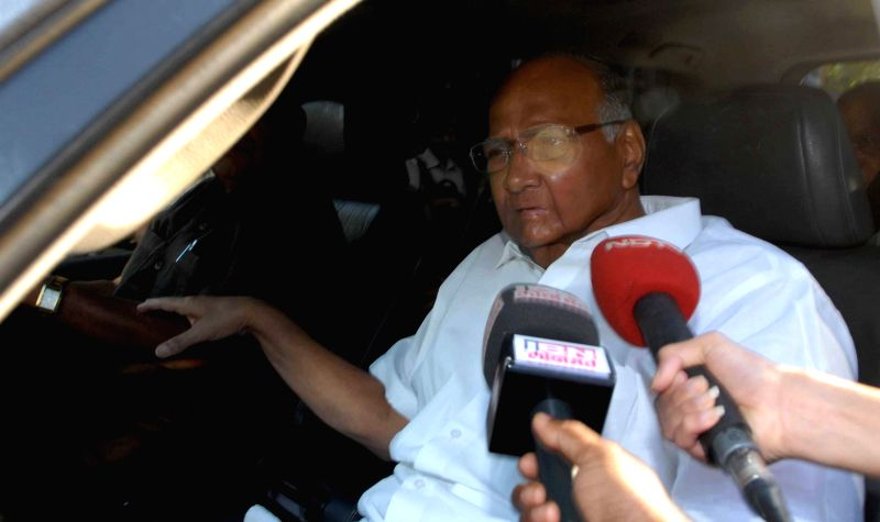 NCP chief Sharad Pawar leaves after visiting J J Hospital to pay his last tribute to Communist leader Govind Pansare in Mumbai on Feb 21, 2015. Veteran Left leader Govind Pansare who was shot ...