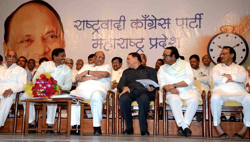 NCP chief Sharad Pawar with party leaders Sunil Tatkare, Ajit Pawar, Chhagan Bhujbal and others during a party meeting in Mumbai on April 29, 2015.