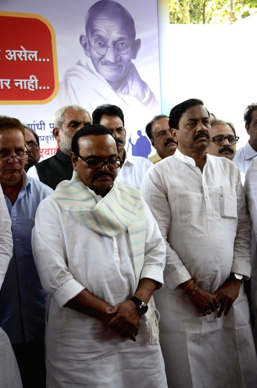 NCP leader Chagan Bhujbal, state unit president Sunil Tatkare, opposition leader in Maharshtra assembly Dhananjay Munde and other leaders paying homage to Mahatma Gandhi on his death ...