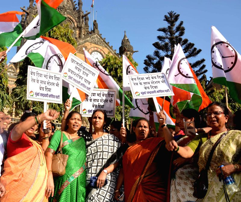 NCP's women wing stage a demonstration against Rail Budget 2015-16 in Mumbai, on Feb 27, 2015.