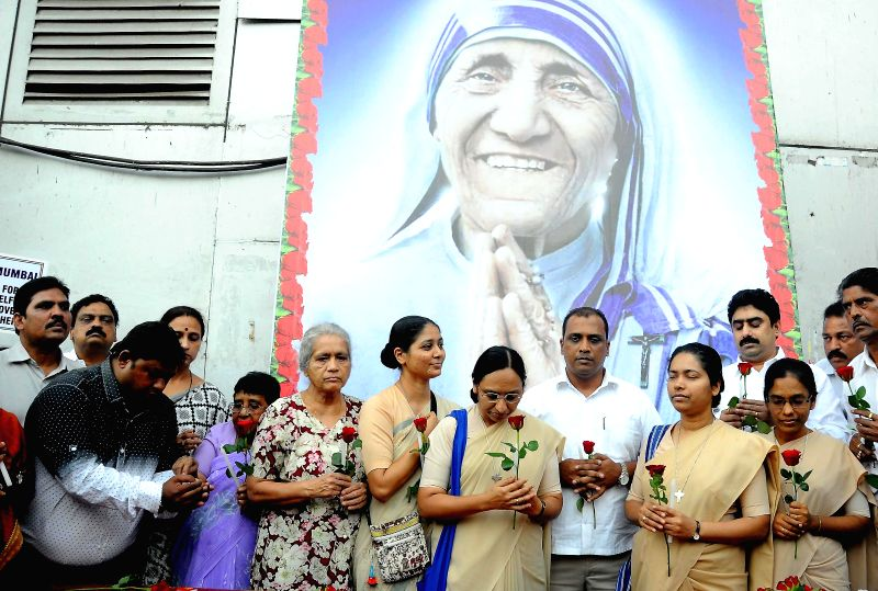 NCP workers pay tribute to Mother Teresa at Churchgate in Mumbai, on Feb 27, 2015.