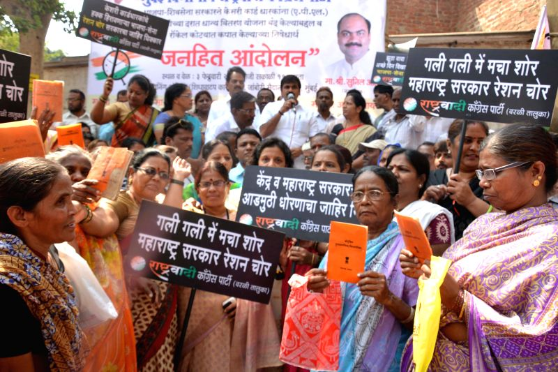 NCP workers protest against orange coloured ration card in Mumbai on Feb. 3, 2015.
