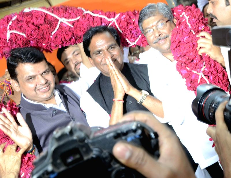 Newly appointed Maharashtra BJP chief Raosaheb Danve Patil with Maharashtra Chief Minister Devendra Fadnavis during a programme organised at BJP office in Mumbai on Jan 8, 2015. - Devendra Fadnavis