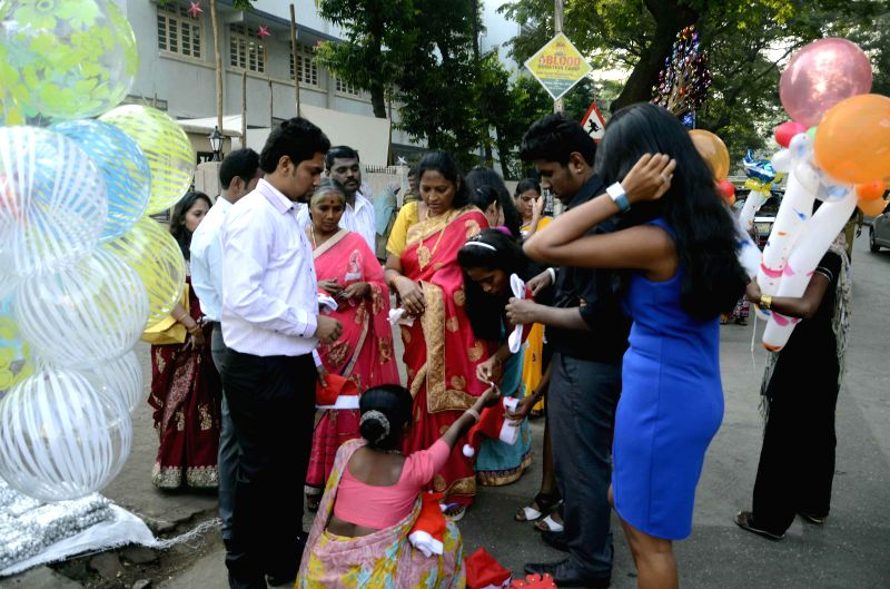 People celebrate Christmas in Mumbai on Dec 25, 2014.