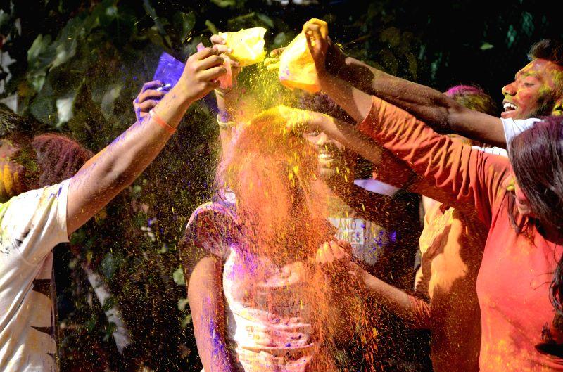 People celebrate Holi in Mumbai, on March 6, 2015.