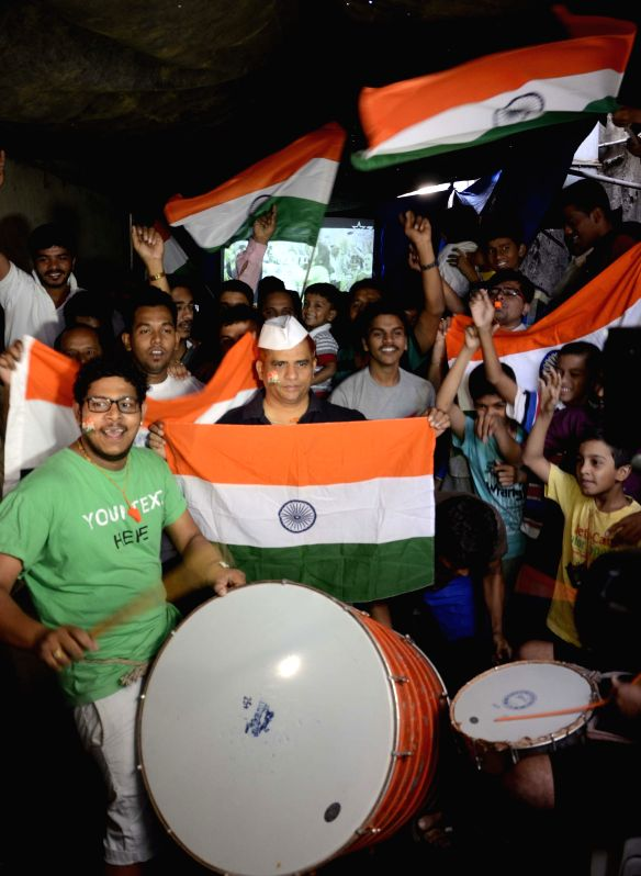 People in a festive mood during a ICC World Cup 2015 match between India and Pakistan on a large screen in Mumbai, on Feb 15, 2015.