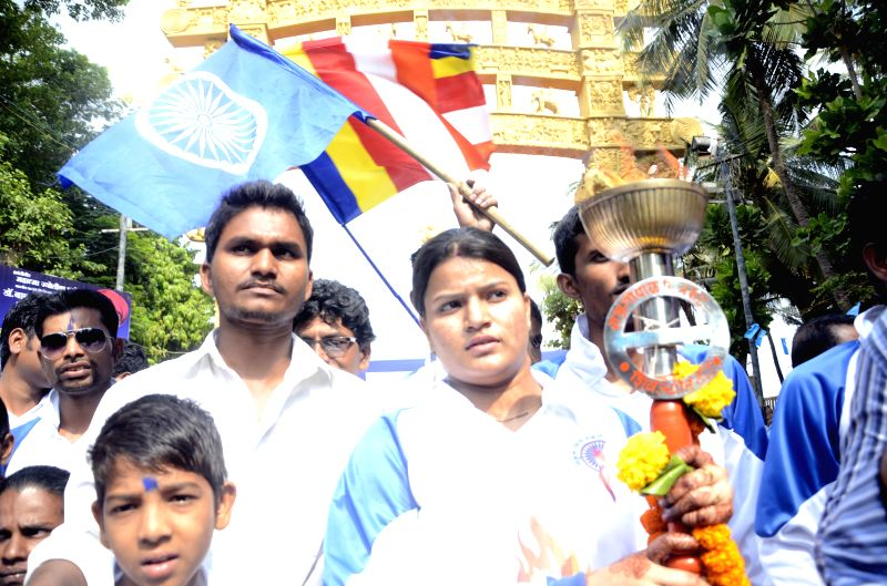 People participate in a programme organised on Ambedkar Jayanti at Chaitya Bhoomi in Mumbai on April 14, 2015.