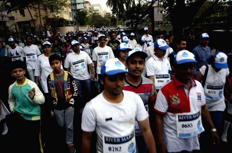 People participate in `River March` - a march organised to spread awareness regarding importance of rivers - in Dahisar of Mumbai on March 1, 2015.
